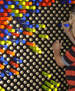Kid playing with giant lite brite